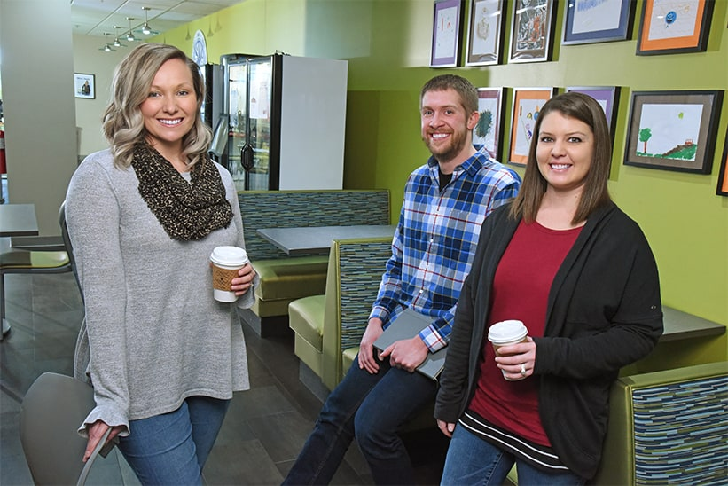 4imprint employees enjoying coffee together
