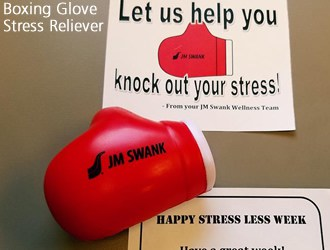 Boxing glove stress reliever with sign