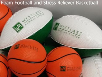 White and green football and orange basketball stress relievers